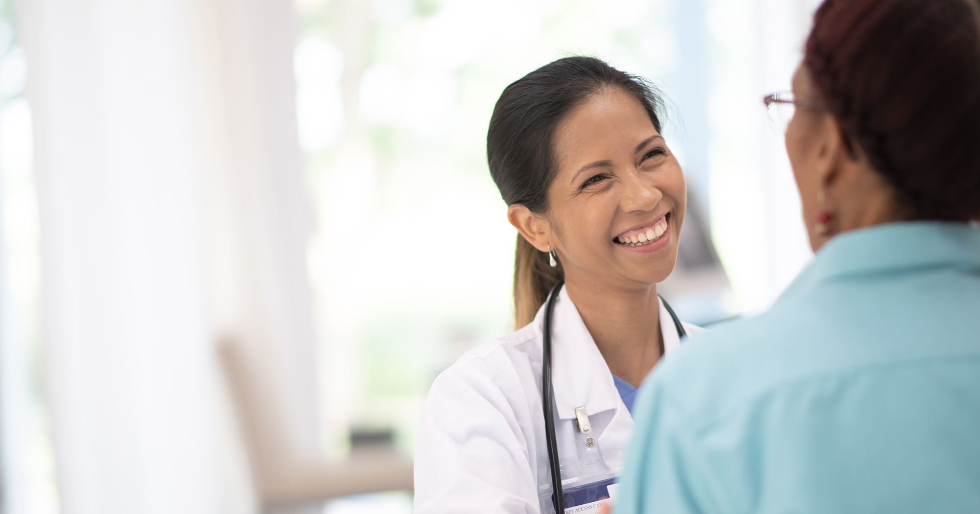 patient talks with general practitioner during annual checkup