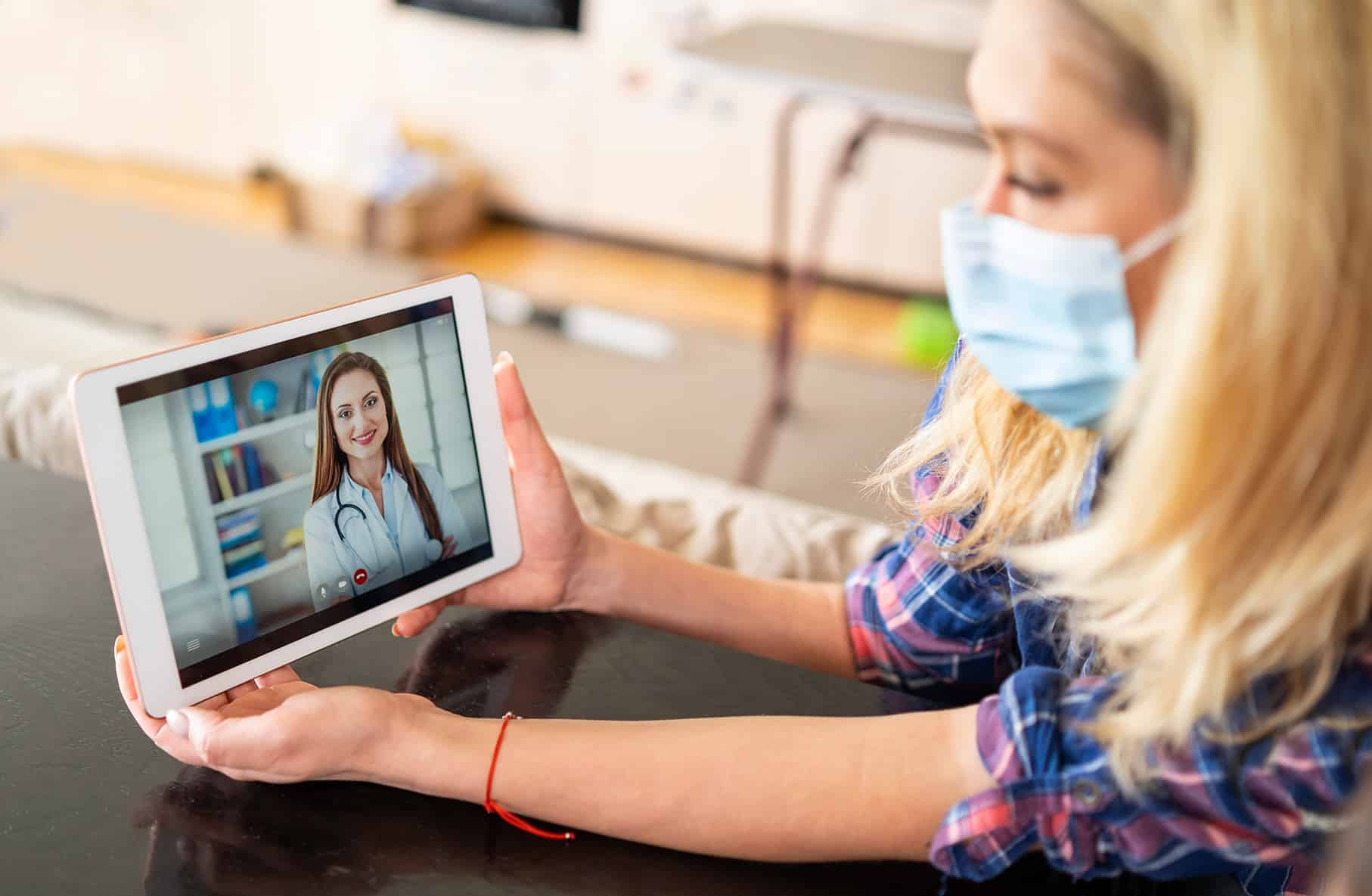 woman having a telehealth consultation with her doctor