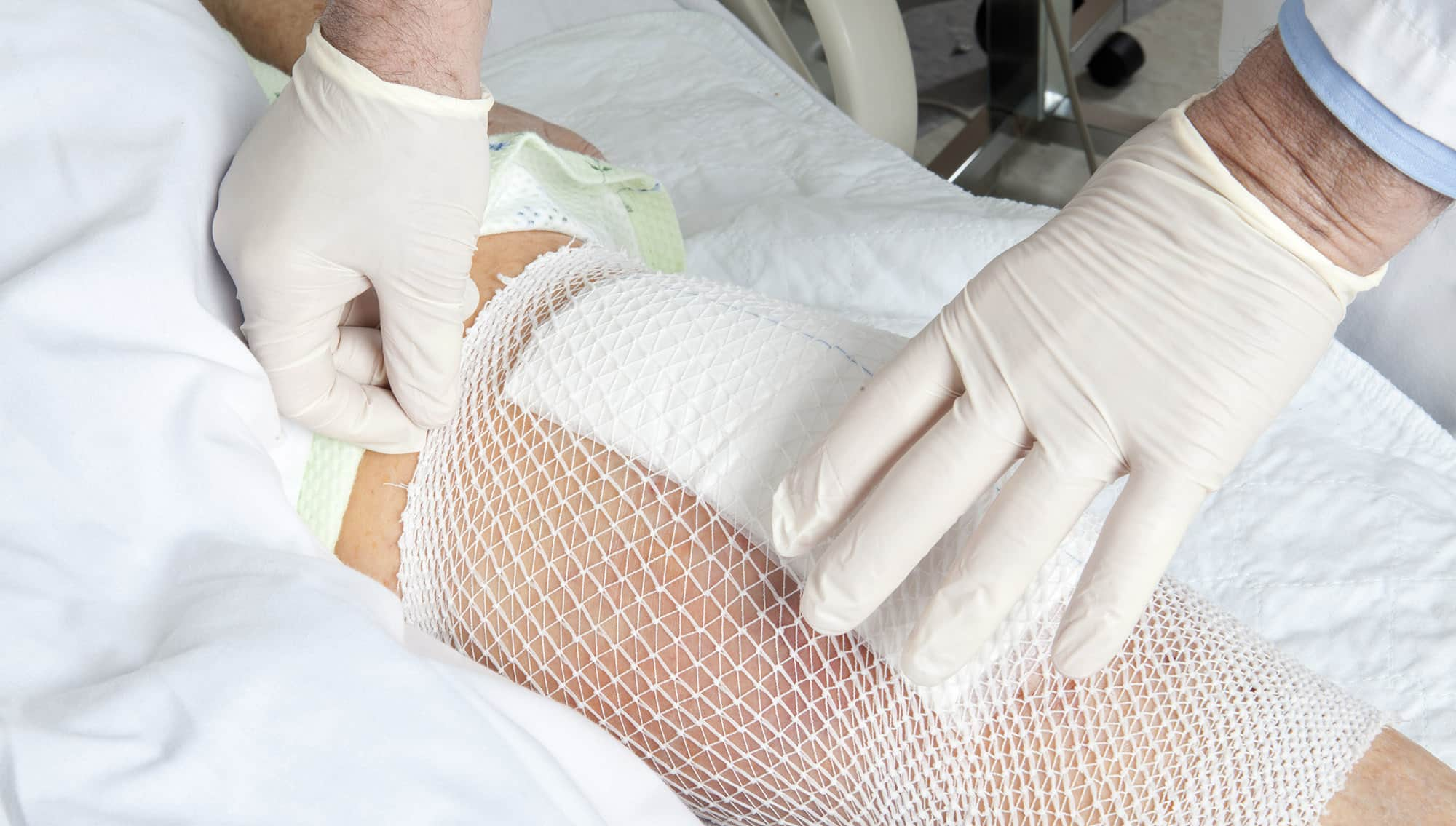 general practitioner fixing and cleaning wound